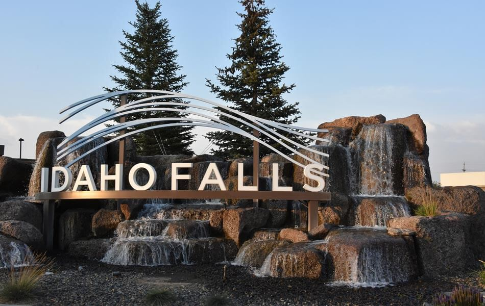 Idaho Falls sign over waterfall rocks